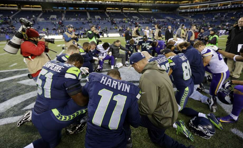 Seattle Seahawks' wide receiver Percy Harvin (11) joins a group of players in kneeling on the field after the Seahawks beat the Minnesota Vikings 41-20 in an NFL football game, Sunday, Nov. 17, 2013, in Seattle. (AP Photo/Ted S. Warren) Photo: Ted S. Warren, AP