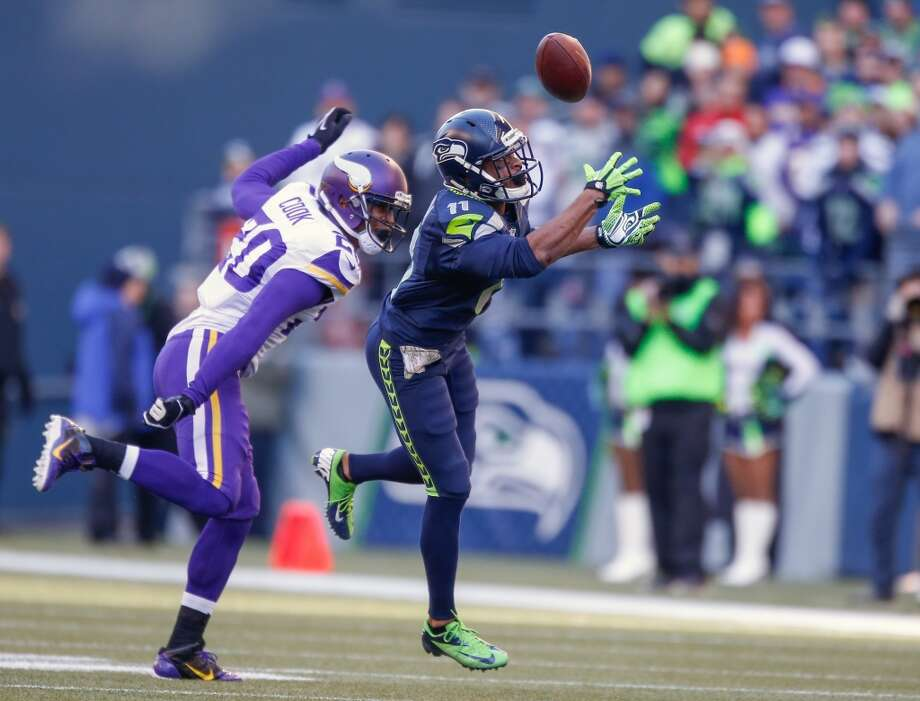 Wide receiver Percy Harvin #11 of the Seattle Seahawks makes a catch against cornerback Chris Cook #20 of the Minnesota Vikings at CenturyLink Field on November 17, 2013 in Seattle, Washington.  (Photo by Otto Greule Jr/Getty Images) Photo: Otto Greule Jr, Getty Images
