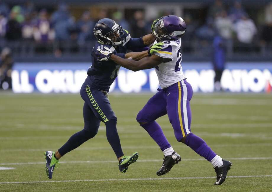 Seattle Seahawks' Percy Harvin, left, in action against Minnesota Vikings' Xavier Rhodes in the second half of an NFL football game, Sunday, Nov. 17, 2013, in Seattle. (AP Photo/Ted S. Warren) Photo: Ted S. Warren, AP