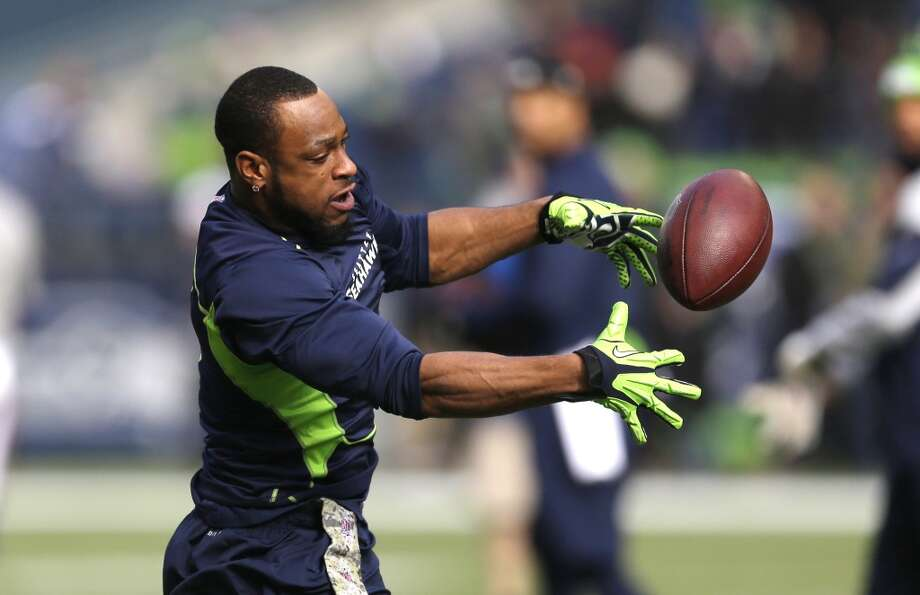Seattle Seahawks' Percy Harvin reaches for a ball as he warms-up on the field before an NFL football game against the Minnesota Vikings, Sunday, Nov. 17, 2013, in Seattle. (AP Photo/Ted S. Warren) Photo: Ted S. Warren, AP