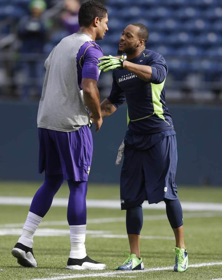 Seattle Seahawks' Percy Harvin embraces an unidentified Minnesota Vikings' player on the field before an NFL football game, Sunday, Nov. 17, 2013, in Seattle. (AP Photo/Ted S. Warren) Photo: Ted S. Warren, AP
