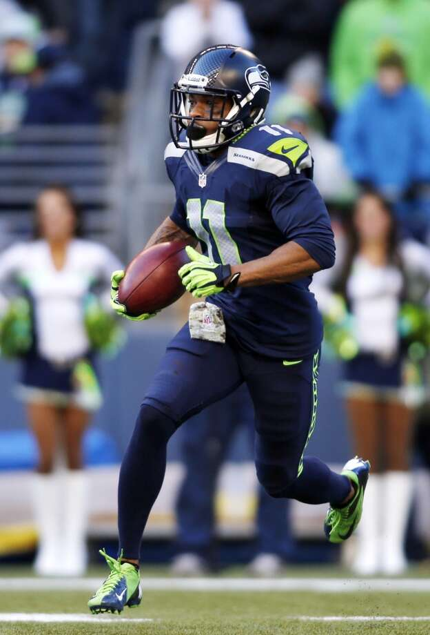 Seattle Seahawks' Percy Harvin returns the ball against the Minnesota Vikings on a kick off in the first half of an NFL football game Sunday, Nov. 17, 2013, in Seattle. (AP Photo/John Froschauer) Photo: JOHN FROSCHAUER, ASSOCIATED PRESS