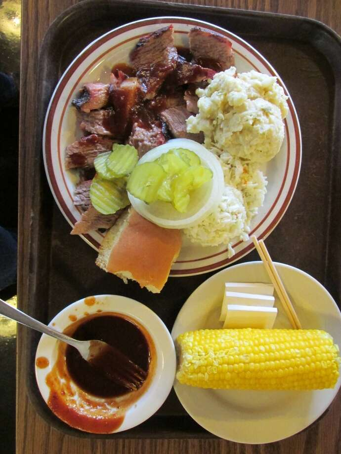 Sliced beef with sides and an extra side of homemade barbecue sauce at JB's Barbecue in Orange. Photo: Cat5