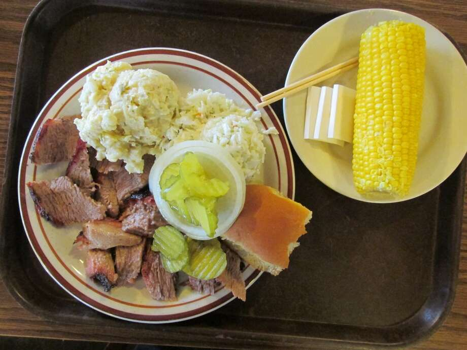 Sliced beef with coleslaw, potato salad and corn on the cob at JB's Barbecue. Photo: Cat5