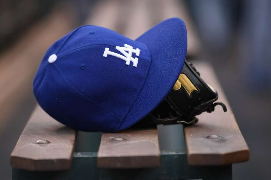 3. Get caught wearing a Dodgers hat. Photo: Doug Pensinger, Getty Images