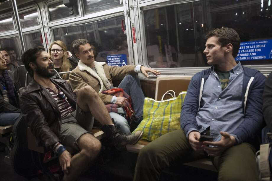 "Frankie J. Alvarez, Murray Bartlett and Jonathan Groff ride the Muni bus during a scene in ""Looking."" They also ride on a Muni train in the pilot. Photo: David Moir, HBO"