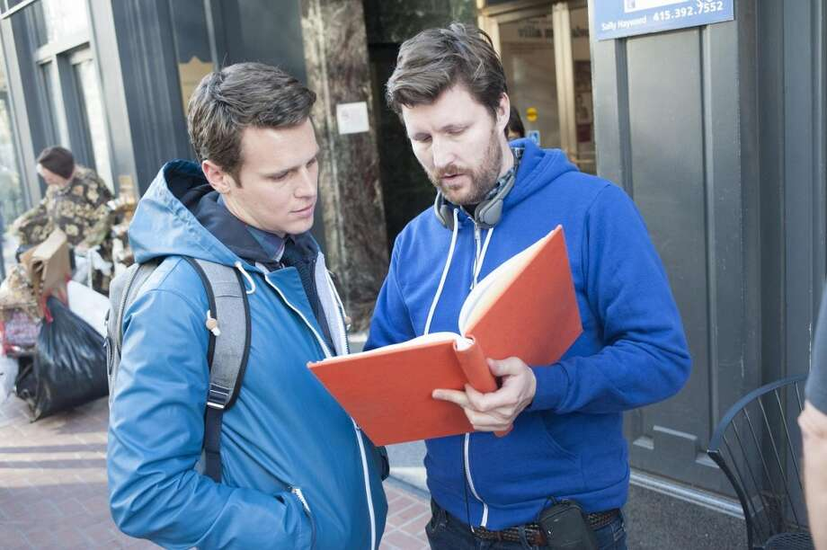 "Andrew Haigh and Jonathan Groff going over a scene in ""Looking."" Photo: David Moir, HBO"
