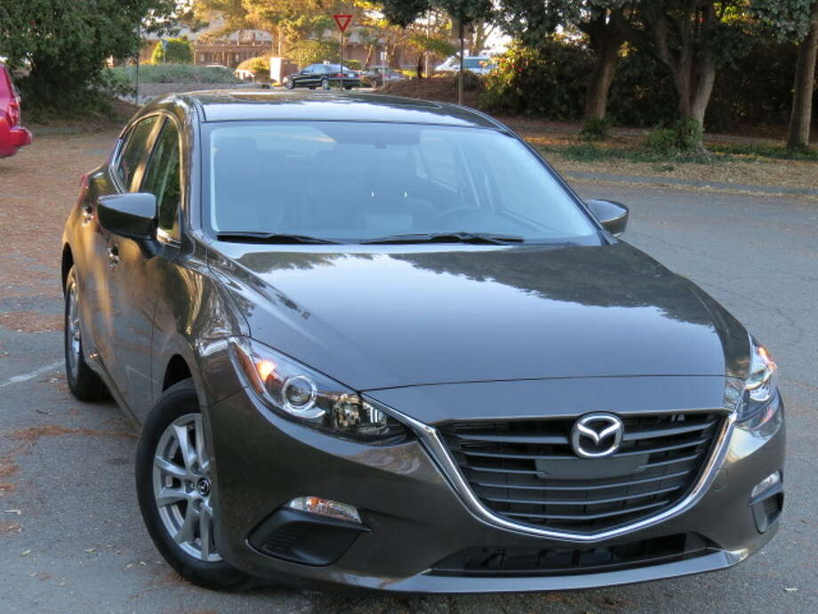 On the outside, Mazda3 designers made the grille deep and dark, almost like some of the Audi grilles, and it gives a sense of serious purpose to the car. The body lines flow in a muscular way back to the hatchback (a sedan is also offered) and the overall effect is one of a car that says it wants to get out there and perform.