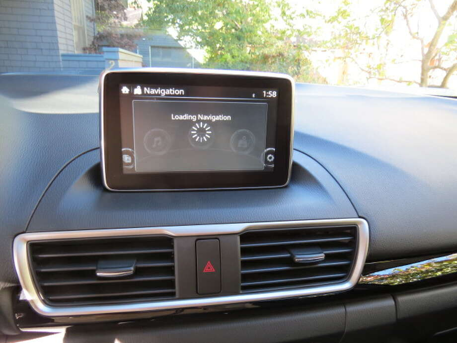 Mazda sticks its navigation screen on top of the dash and it's there forever, like it or not. It sticks up like a portable GPS and looks awkward, like an afterthought. With some cars, a dashboard-mounted screen recedes into the dashboard's innards when not in use. Not with Mazda. It's just there. At one point, when I asked for navigation, it spent the next 15 minutes trying to load the navigator. I finally switched off the ignition. When I started it back up, the navigation came back to life.