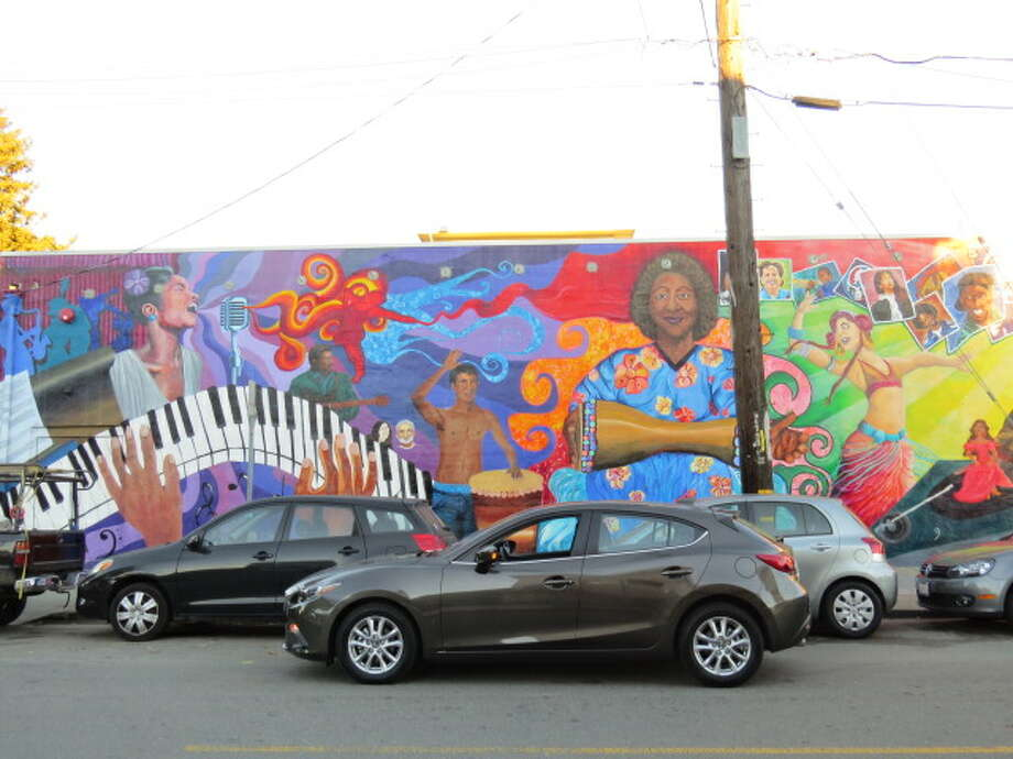 It's a mural on the wall of a building in Berkeley, Calif., and the Mazda3 is in the foreground.
