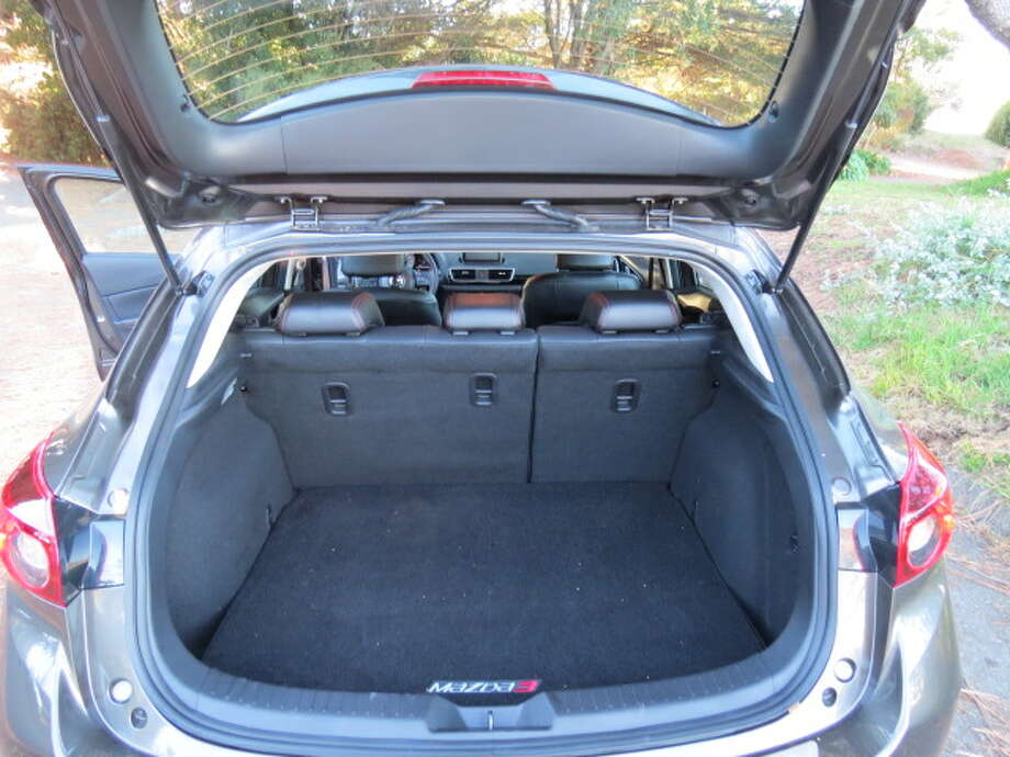 There's plenty of room in the rear for a weekend's worth of luggage, groceries and the like, but it's still a compact car and you have to lower the second row of seats to get substantial cargo space.