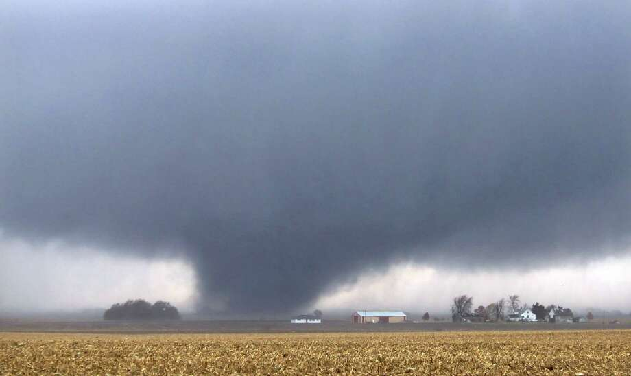 A tornado moves northeast Sunday, Nov. 17, 2013, two miles west of Flatville, Ill. The tornado damaged many farm buildings and homes on its way to Gifford, Ill., where scores of houses were devastated. Photo: John Dixon, AP / News-Gazette