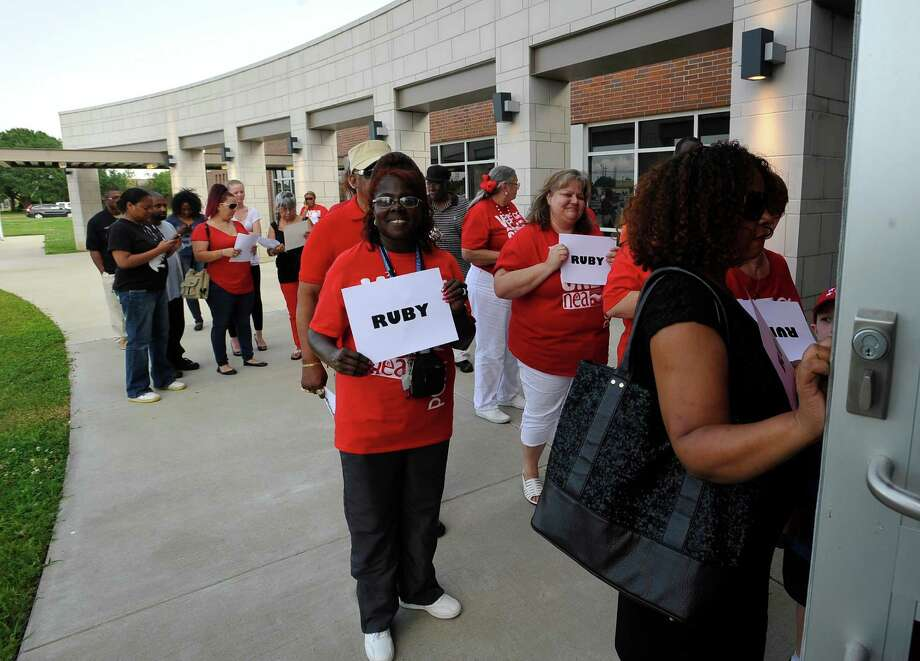 Teachers and friends from around the area who were gathered outside of the Port Arthur Independent School District Administration building Thursday night, try to file in as the school board begins their meeting, to show their support of Ruby Gunner.  Gunner has been suspended by the board after being accused of attacking a fourth grade student.  Dave Ryan/The Enterprise