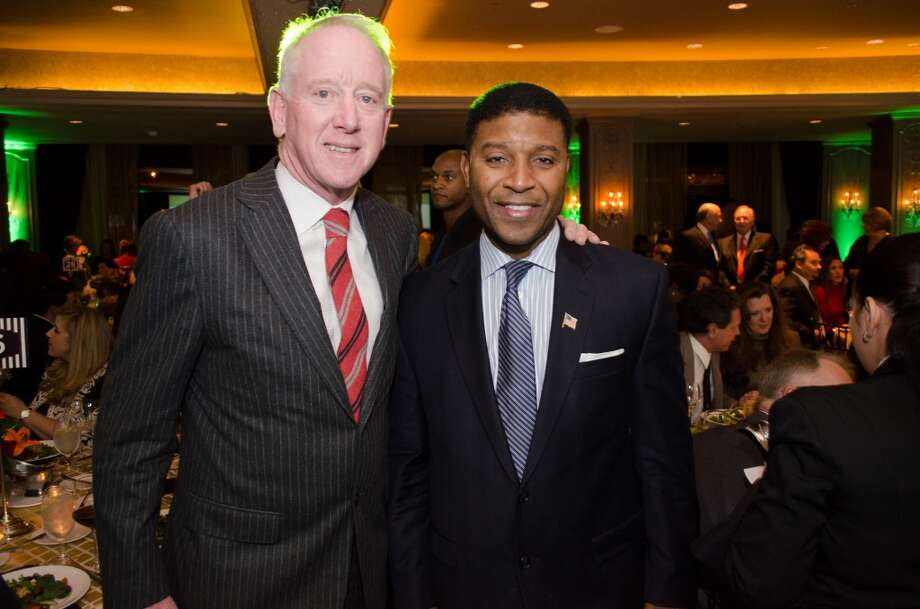 Archihe Manning with Emcee and CBS College Football Analyst Spencer Tillman during the Touchdown for Knowledge Arts Foundation Event on Wednesday, November 13, 2013 at Hotel Zaza in Houston, TX Photo: Jamaal Ellis, For The Chronicle