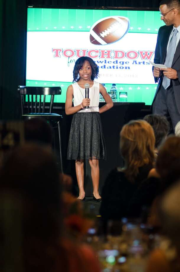 Cullen Middle School 8th grader Jada Edison during an improptu interview given by her principal Clayton Crook during theTouchdown for Knowledge Arts Foundation Event on Wednesday, November 13, 2013 at Hotel Zaza in Houston, TX Photo: Jamaal Ellis, For The Chronicle