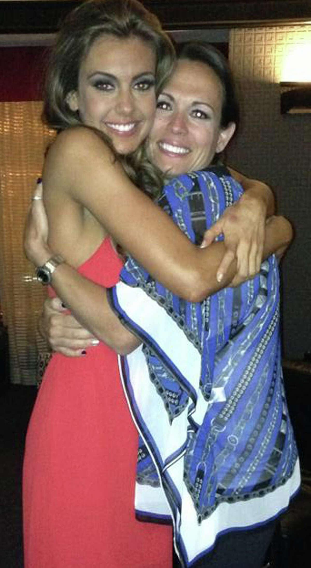 Erin Brady of East Hampton gives an appreciative hug to Tiffany Delmonico moments before winning the Miss USA pageant. 2013 Courtesy of Tiffany Delmonico