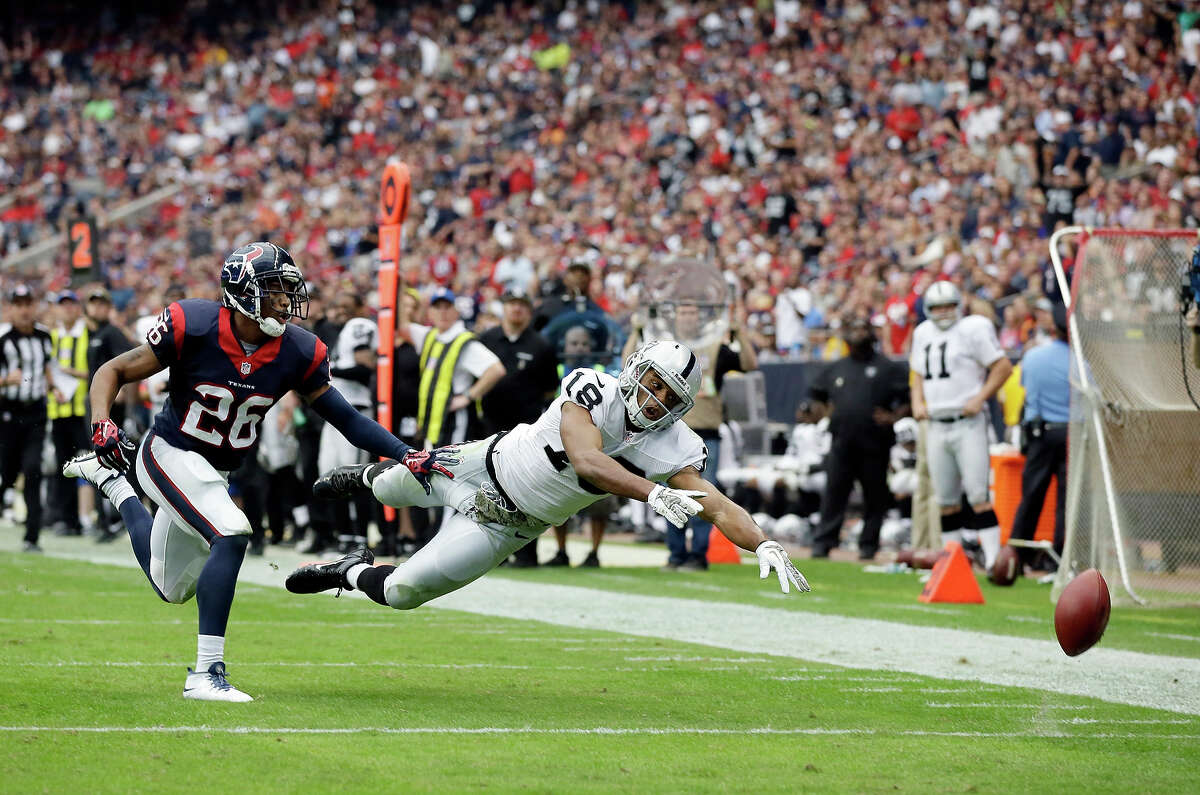 Houston Texans' Brandon Harris breaks up a pass intended for Oakland Raiders' Andre Holmes during the second half of an NFL football game Sunday, Nov. 17, 2013, in Houston.