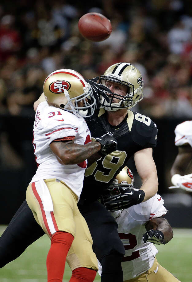 San Francisco 49ers strong safety Donte Whitner (31) breaks up a pass intended for New Orleans Saints tight end Josh Hill (89) in the second half of an NFL football game in New Orleans, Sunday, Nov. 17, 2013. Photo: Dave Martin, AP / AP