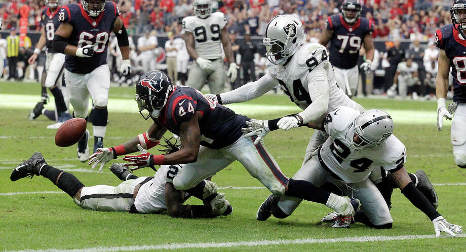 Houston Texans' Ben Tate fumbles near the goal line during the second half of an NFL football game against the Oakland Raiders Sunday, Nov. 17, 2013, in Houston.Tate recovered his own fumble  The Raiders won 28-23. Photo: Patric Schneider, AP / FR170473 AP