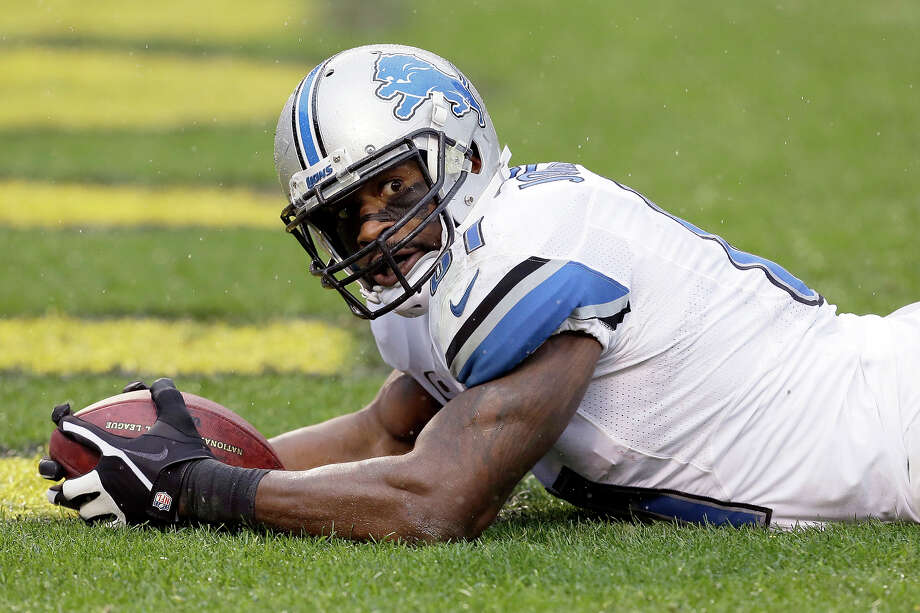 Detroit Lions wide receiver Calvin Johnson (81) lays in the end zone after making a touchdown catch in the second quarter of an NFL football game against the Pittsburgh Steelers in Pittsburgh, Sunday, Nov. 17, 2013. The pass put quarterback Matthew Stafford (9) ahead of  Bobby Layne's Lions' career passing yardage. Photo: Gene J. Puskar, AP / AP