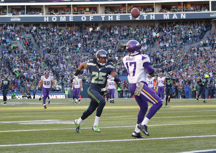 Seattle Seahawks' Richard Sherman closes in on Minnesota Vikings' Jarius Wright as he catches a pass in the first half of an NFL football game, Sunday, Nov. 17, 2013, in Seattle. Photo: John Froschauer, AP / FR74207 AP
