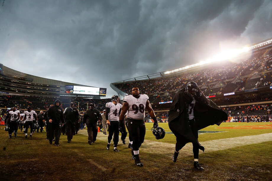 Baltimore Ravens players leave the field as play was suspended for a severe thunderstorm blowing through Soldier Field during the first half of an NFL football game against the Chicago Bears, Sunday, Nov. 17, 2013, in Chicago. Photo: Charles Rex Arbogast, ASSOCIATED PRESS / AP2013