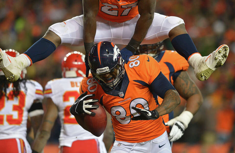 Denver Broncos running back Knowshon Moreno (27) leaps over Denver Broncos tight end Julius Thomas (80) after Thomas caught a touchdown pass against the Kansas City Chiefs in the first quarter of an NFL football game, Sunday, Nov. 17, 2013, in Denver. Photo: Jack Dempsey, ASSOCIATED PRESS / AP2013