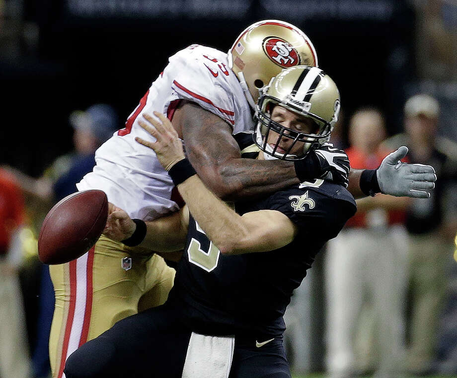 New Orleans Saints quarterback Drew Brees (9) is sacked by San Francisco 49ers outside linebacker Ahmad Brooks (55) in the second half of an NFL football game in New Orleans, Sunday, Nov. 17, 2013. Photo: Dave Martin, AP / AP