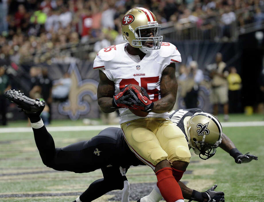 San Francisco 49ers tight end Vernon Davis (85) pulls in a touchdown pass in front of New Orleans Saints free safety Malcolm Jenkins (27) in the second half of an NFL football game in New Orleans, Sunday, Nov. 17, 2013. Photo: Dave Martin, AP / AP
