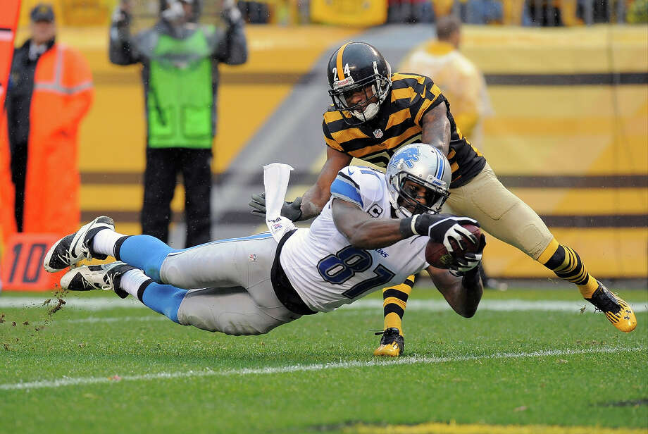 Detroit Lions wide receiver Calvin Johnson (81) dives for a touchdown after making a catch in front of Pittsburgh Steelers cornerback Ike Taylor (24) in the first half of an NFL football game on Sunday, Nov. 17, 2013, in Pittsburgh. Photo: Don Wright, AP / FR87040 AP