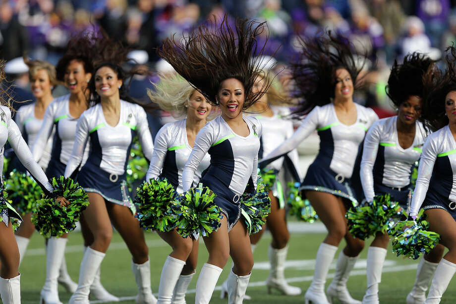 Seattle Seahawks Sea Gals cheerleaders perform during an NFL football game against the Minnesota Vikings, Sunday, Nov. 17, 2013, in Seattle. Photo: Ted S. Warren, AP / AP