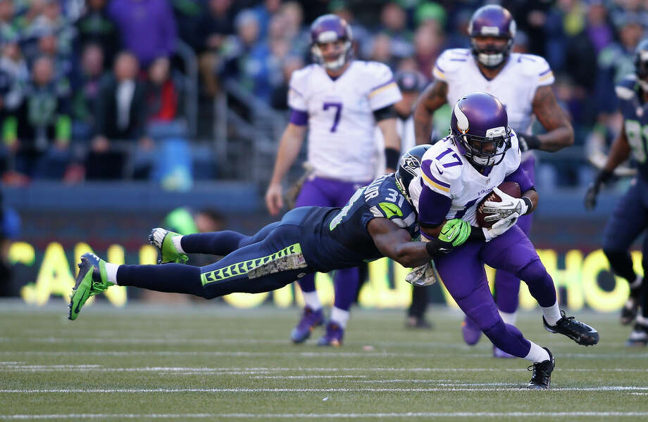 Minnesota Vikings' Jarius Wright carries the ball and is hit by Seattle Seahawks' Kam Chancellor in the first half of an NFL football game, Sunday, Nov. 17, 2013, in Seattle. Photo: John Froschauer, ASSOCIATED PRESS / AP2013