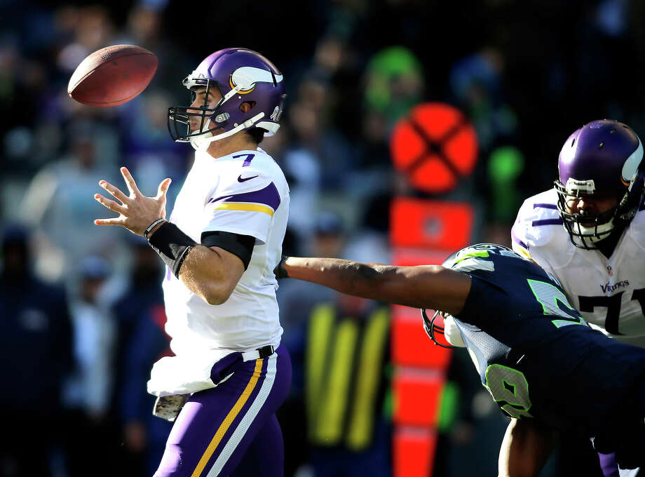 Minnesota Vikings quarterback Christian Ponder, left, loses the ball as he is hit by Seattle Seahawks' Cliff Avril in the first half of an NFL football game Sunday, Nov. 17, 2013, in Seattle. Photo: John Froschauer, ASSOCIATED PRESS / AP2013