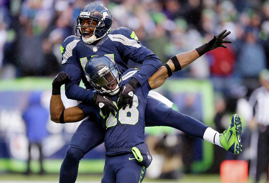 Seattle Seahawks' Byron Maxwell, top, leaps on the back of Walter Thurmond after Thurmond intercepted and scored against the Minnesota Vikings in the second half of an NFL football game Sunday, Nov. 17, 2013, in Seattle. Photo: Ted S. Warren, ASSOCIATED PRESS / AP2013