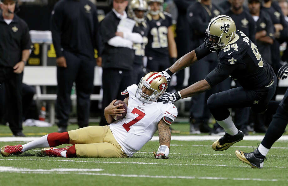 San Francisco 49ers quarterback Colin Kaepernick (7) slides as he is stopped by New Orleans Saints defensive end Cameron Jordan (94) in the first half of an NFL football game in New Orleans, Sunday, Nov. 17, 2013. Photo: Dave Martin, AP / AP