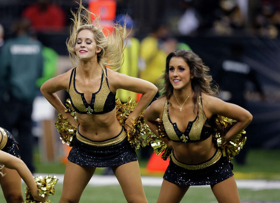 New Orleans Saints cheerleaders perform in the first half of an NFL football game against the San Francisco 49ers in New Orleans, Sunday, Nov. 17, 2013. Photo: Bill Haber, ASSOCIATED PRESS / AP2013