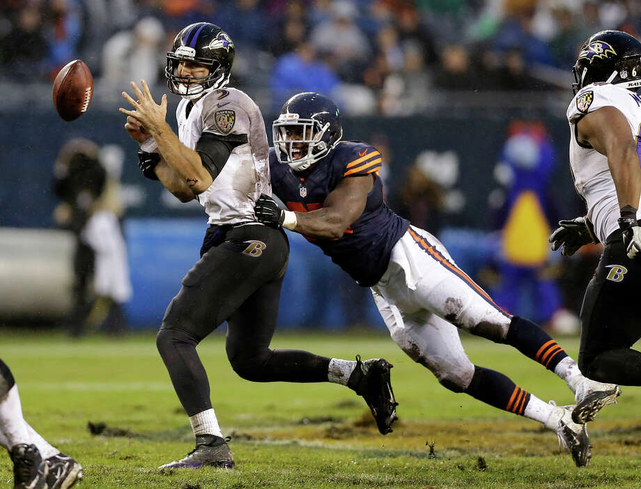 Chicago Bears linebacker Larry Grant, right, sacks Baltimore Ravens quarterback Joe Flacco (5) during the second half of an NFL football game, Sunday, Nov. 17, 2013, in Chicago. Photo: Nam Y. Huh, ASSOCIATED PRESS / AP2013