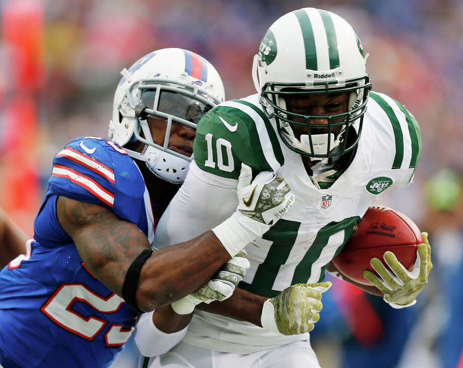 New York Jets wide receiver Santonio Holmes (10) is knocked out of bounds by Buffalo Bills free safety Aaron Williams (23) during the second half of an NFL football game on Sunday, Nov. 17, 2013, in Orchard Park, N.Y. Photo: Gary Wiepert, ASSOCIATED PRESS / A2011
