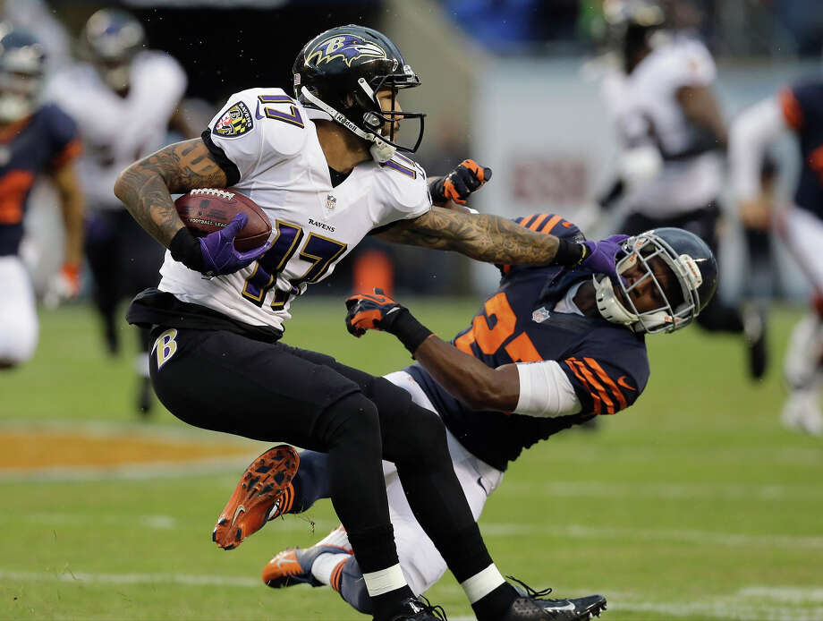Baltimore Ravens wide receiver Tandon Doss (17) pushes off Chicago Bears defensive back Sherrick McManis (27) during the first half of an NFL football game, Sunday, Nov. 17, 2013, in Chicago. Photo: Nam Y. Huh, ASSOCIATED PRESS / AP2013