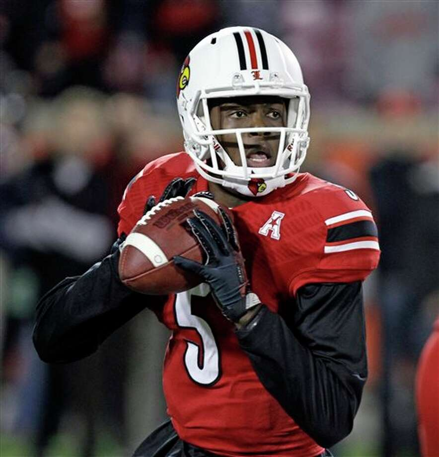 UH held Louisville's Teddy Bridgewater in check but wasn't enough for the win. Photo: Garry Jones, AP / FR50389 AP