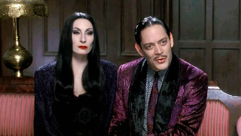 "Anjelica Huston and Raul Julia in the 1993 film ""Addams Family Values."""