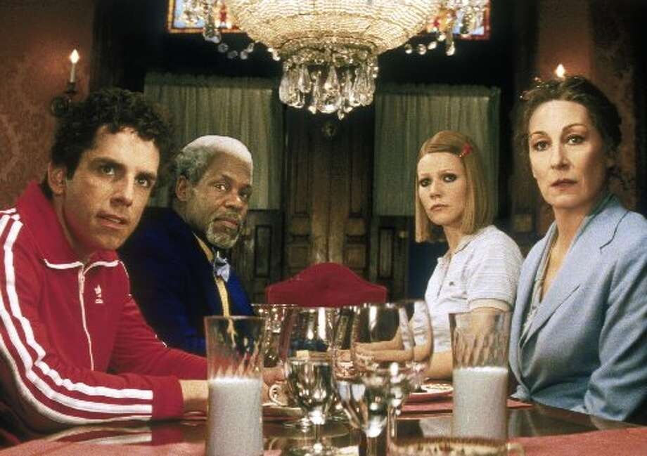 Cast  members of Touchstone Pictures 'The Royal Tenenbaums,' appear in this promotional photo, 2001. From left, are Ben Stiller, Danny Glover, Gywneth Paltrow, and Anjelica Huston at the Tenenbaum dinner table. (AP Photo/Touchstone Pictures)