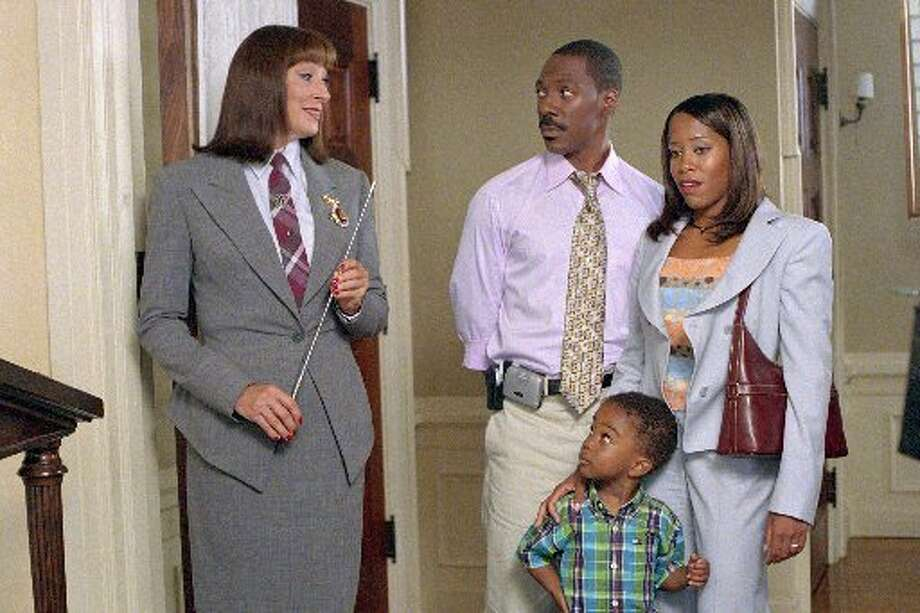Anjelica Huston plays the headmistress of the Chapman Academy at which Charlie (Eddie Murphy) and Kim (Regina King) hope to enroll their son Ben (Khamani Griffin) in Revolution Studios family comedy Daddy Day Care, a Columbia Pictures release in 2003. Photo credit: Bruce McBroom.
