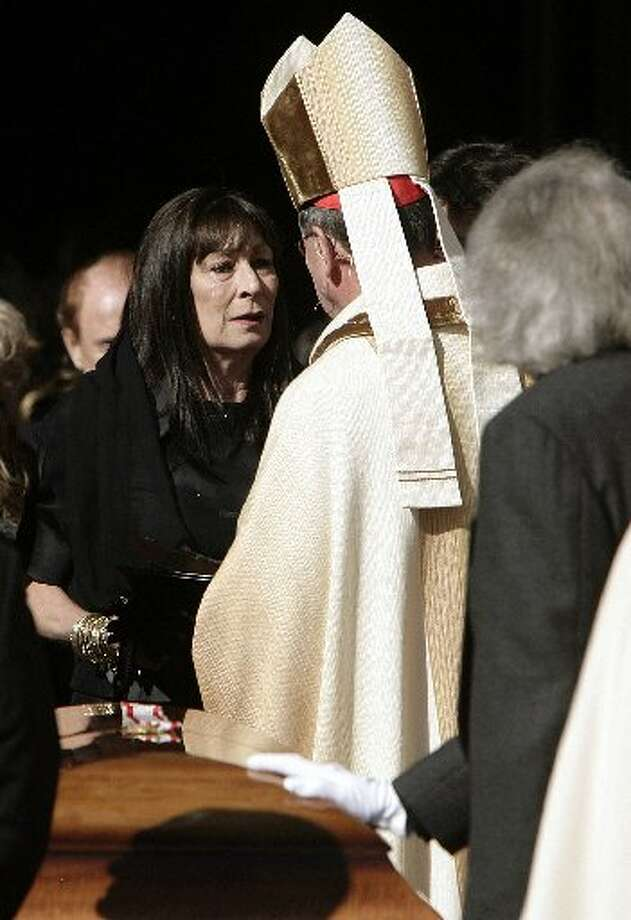 Actress Anjelica Huston, left, speaks with Cardinal Roger Mahony following the funeral for her late husband Robert Graham Wednesday, Jan. 7, 2009, at the Cathedral of Our Lady of the Angels in Los Angeles. Graham designed the great bronze doors for the cathedral. (AP Photo/Ric Francis, Pool)
