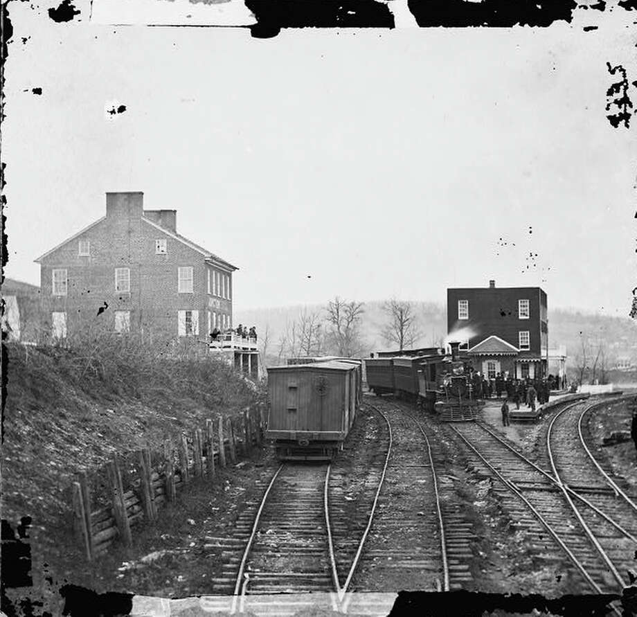 A passenger train at the depot at Hanover Junction, York County, Pennsylvania, 1863. The station is on the Hanover Junction, Hanover and Gettysburg Railroad. President Abraham Lincoln traveled via this station in November 1863, on his way to the Gettysburg National Cemetery. Photograph by Mathew Brady. Photo: Library Of Congress, Getty Images / Archive Photos