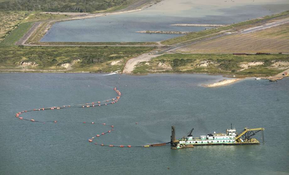 Dredging operations occur at the La Quinta Channel expansion at Ingleside, TX. Photo: Bob Owen, San Antonio Express-News