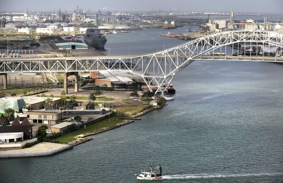 A shrimping boat heads back to dock as it passes the opening of Port Corpus Christi. Photo: Bob Owen, San Antonio Express-News