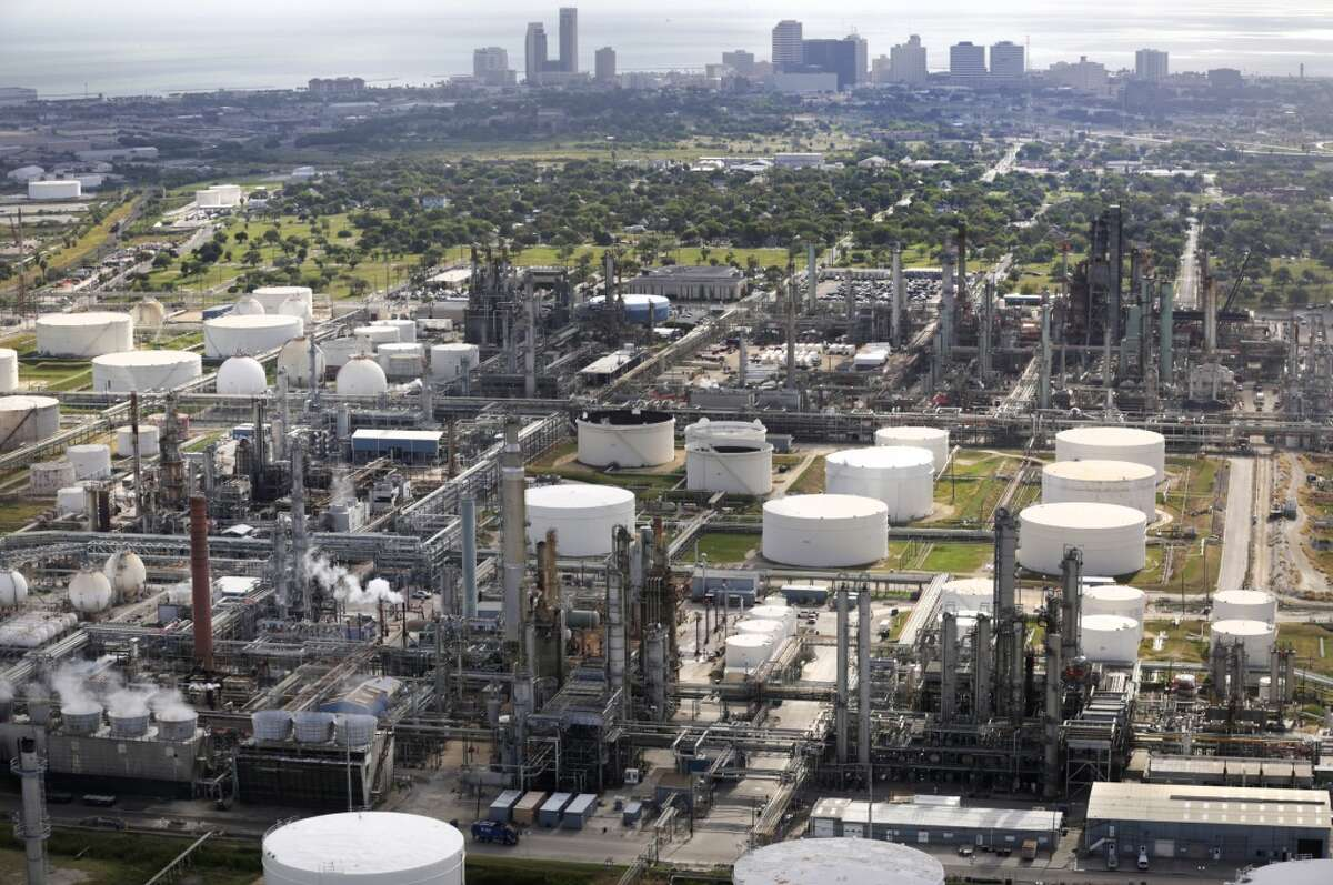 The Corpus Christi skyline looms behind oil refineries next to Port Corpus Christi.
