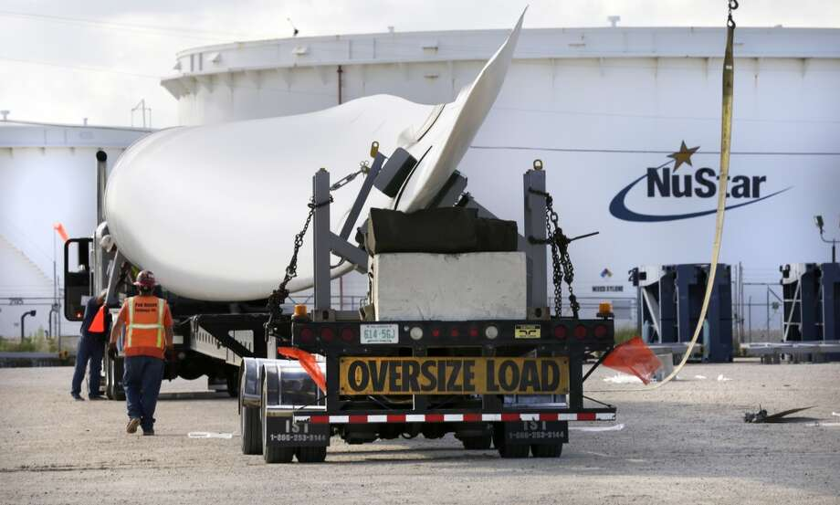A wind turbine blade is loaded for transport in Port Corpus Christi. Photo: Bob Owen, San Antonio Express-News