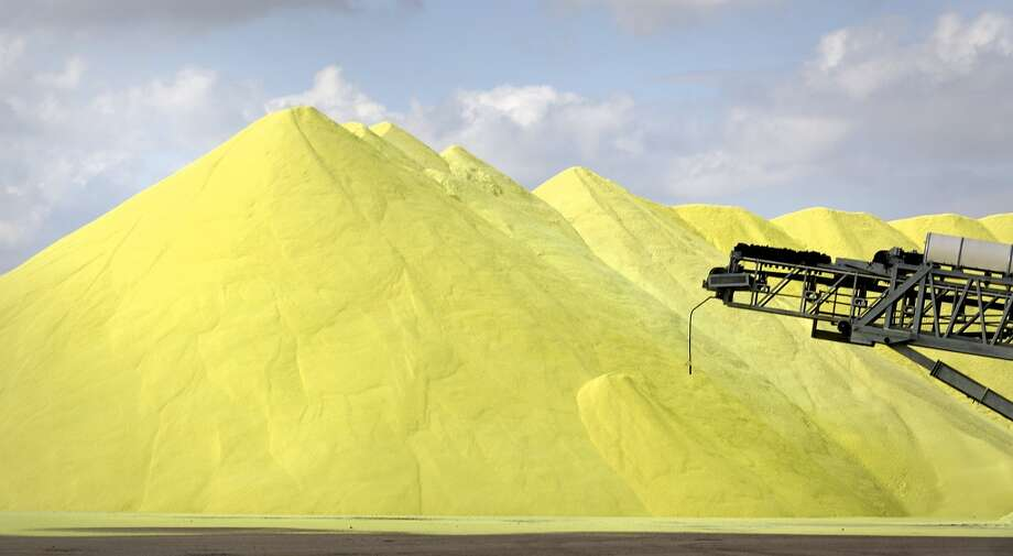 Large mounds of sulfur, a byproduct of refining, sit in a lot in Port Corpus Christi. Photo: Bob Owen, San Antonio Express-News